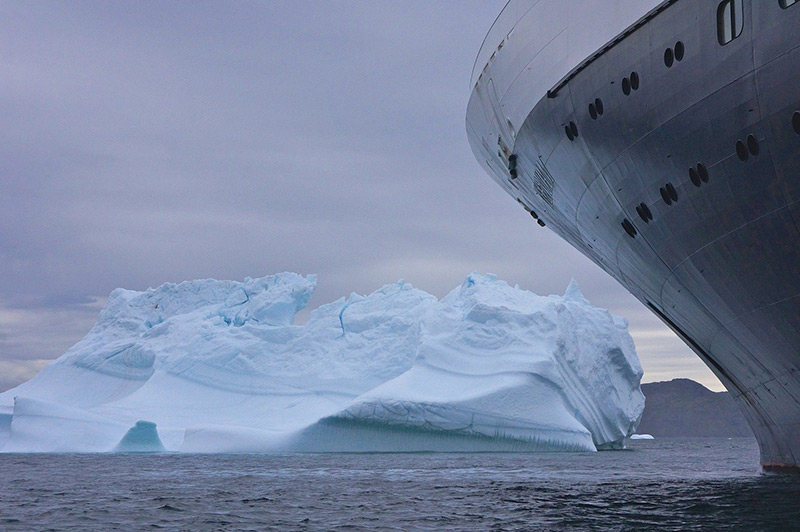 ship vessel next to an iceberg